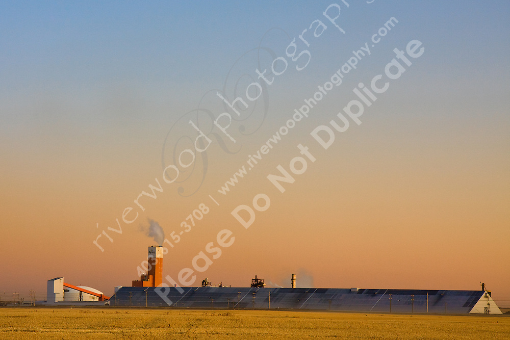 I was really enjoying watching the vibrant colors of the sunset as the pink line above the horizon slowly receded.  I love how the factory site (a fertilizer manufacturing plant) stands out against the Yellow of the farm field and the blue sky above it...©2009, Sean Phillips.http://www.Sean-Phillips.com
