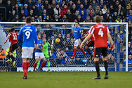 Portsmouth Midfielder, Ben Thompson (32) with a headed clearance  during the EFL Sky Bet League 1 match between Portsmouth and Sunderland at Fratton Park, Portsmouth, England on 22 December 2018.
