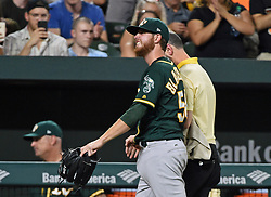 August 22, 2017 - Baltimore, MD, USA - Oakland Athletics pitcher Paul Blackburn grimaces as he leaves the field after he was hit by a come-backer hit by the Baltimore Orioles' Trey Mancini in the fifth inning at Oriole Park at Camden Yards in Baltimore on Tuesday, Aug. 22, 2017. The A's won, 6-4. (Credit Image: © Kenneth K. Lam/TNS via ZUMA Wire)
