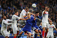 Cardiff City's Lex Immers ( centre) and Sean Morrison are beaten in the air by Wigan's Jake Buxton. EFL Skybet championship match, Cardiff city v Wigan Athletic at the Cardiff city stadium in Cardiff, South Wales on Saturday 29th October 2016.<br /> pic by Carl Robertson, Andrew Orchard sports photography.