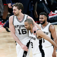 03 May 2017: San Antonio Spurs guard Jonathon Simmons (17) celebrates with San Antonio Spurs guard Tony Parker (9) and San Antonio Spurs guard Patty Mills (8) during the San Antonio Spurs 121-96 victory over the Houston Rockets, in game 2 of the Western Conference Semi Finals, at the AT&T Center, San Antonio, Texas, USA.