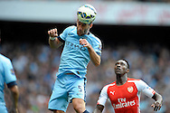 Manchester City's Pablo Zabaleta heads  the ball. Barclays Premier league match, Arsenal v Manchester city at the Emirates Stadium in London on Saturday 13th Sept 2014.<br /> pic by John Patrick Fletcher, Andrew Orchard sports photography.