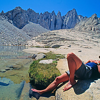 Roger Schley naps by lake under Mount Whitney, highest peak in 48 states.
