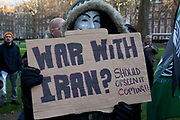 Occupy London protesters join in the rally. Stop The War Coalition rally outside the US Embassy in London. Scuffles broke out during the protest, as opposite sides of the arguement shouted each other down. The protest is in response to inflamatory language being used by the US and UK concerning Iran and Syria. Free Iran supporters were came in strong numbers, to listen to speakers.