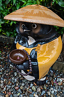 Tanuki Badger at Kanjizaiji - Tanuki is the Japanese word for a raccoon.  These creatures have been represented in Japanese folklore for hundreds of years.  The tanuki have a reputation for being mischievous.  At the same time they are jolly, good at disguising themselves. They are also absent-minded. and gullible according to legend. Kanjizaiji is number 40 of the 88 temples in the Shikoku Pilgrimage and has one of the Nanyo Seven Gods of Fortune or Nanyo Shichi Fukujin.