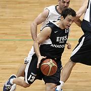 Efes Pilsen's Ender ARSLAN (F) during their Turkish Basketball league derby match Besiktas between Efes Pilsen at the BJK Akatlar Arena in Istanbul Turkey on Saturday 30 April 2011. Photo by TURKPIX