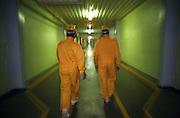 Temelin/Tschechische Republik, Tschechien, CZE, 25.06.2004: Zwei Mitarbeiter in Schutzkleidung auf dem Weg zu ihrem Arbeitsplatz in den Verbindungskorridoren im Atomkraftwerk Temelin. Das Kernkraftwerk steht 24 Km von der Stadt Ceske Budejovice entfernt.<br /> <br /> Temelin/Czech Republic, CZE, 25.06.2004: Two workers in protective clothing walking through corridors to their workplace at the Nuclear Power Station Temelin. The Nuclear Power Plant Temelin is located, approximately 24 km from the town of Ceske Budejovice.