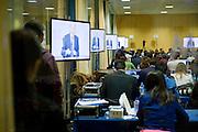Televisive debate between Mariano Rajoy and Alfredo Perez Rubalcaba.Journalist broadcasting the event from the newsrom.