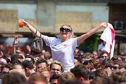 © Licensed to London News Pictures. 07/07/2018. London, UK. England fans wait for the start of the England v Sweden World Cup Quarter Final match as it is shown on the big screen at Flat Iron Square in London. Photo credit: Rob Pinney/LNP