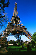 Eiffel Tower and park with blue sky and walkway.