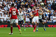 Swindons Michael Smith & Prestons Bailey Wright during the Sky Bet League 1 Play Off Final match between Preston North End and Swindon Town at Wembley Stadium, London, England on 24 May 2015. Photo by Shane Healey.
