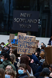 © Licensed to London News Pictures. 14/03/2021. London, UK. Protestors gather outside New Scotland Yard in London for a demonstration, organised by Sisters Uncut, against the actions of the police force at a vigil for murdered Sarah Everard yesterday evening. There have been calls for Met Chief Cressida Dick to resign following yesterday's scenes, when police dragged women away from a bandstand as thousands gathered in Clapham, South London. Photo credit: Ben Cawthra/LNP