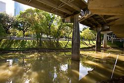 Bufflao Bayou flowing through Buffalo Bayou park along the city's edge in Houston, Texas