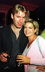 MR STEPHEN BECKETT and TV presenter PENNY SMITH, at a party in London on 12th October 1999.MXM 44