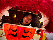 16 FEBRUARY 2018 - BANGKOK, THAILAND:  A woman in a Lion Dancer outfit relaxes at Canton Shrine during Chinese New Year celebrations in the Chinatown neighborhood of Bangkok. Thailand has a large Chinese community and Lunar New Year is widely celebrated, especially in larger cities. This will be the Year of the Dog.      PHOTO BY JACK KURTZ