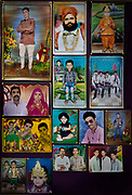 Photographic portrait studios photo display on 29th January 2018  in Jaisalmer, Rajasthan, India. These pre photoshop portraits still use a lot of hand colouring.
