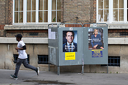 May 6, 2017 - Paris, Paris, France - Paris , France . A man runs passed flyers for Macron and Le Pen in the Saint-Ouen district of Northern Paris . The electorate are voting in the final round of the French election today (7th May 2017) . Emmanuel Macron's En Marche and Marine Le Pen's Front National are competing for the Presidency  (Credit Image: © Joel Goodman/London News Pictures via ZUMA Wire)