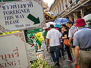 15 OCTOBER 2014 - BANGKOK, THAILAND: Tourists file into the Grand Palace in Bangkok. The number of tourists arriving in Thailand in July fell 10.9 per cent from a year earlier, according to data from the Department of Tourism. The drop in arrivals is being blamed on continued uncertainty about Thailand's political situation. The tourist sector accounts for about 10 per cent of the Thai economy and suffered its biggest drop in visitors in June - the first full month after the army took power on May 22. Arrivals for the year to date are down 10.7% over the same period last year.   PHOTO BY JACK KURTZ
