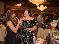 """Sharing a """"toast"""" with a glass of Rose from the Treasury Wine Estates during the Winnipesaukee Wine Festival at Church Landing in Meredith.  (Karen Bobotas Photographer)"""