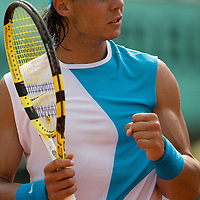 04 June 2007: Spanish player Rafael Nadal pumps his fist during the French Tennis Open fourth round match won 6-3, 6-1, 7-6 (7/5) by Rafael Nadal over Lleyton Hewitt on day 9 at Roland Garros, in Paris, France.