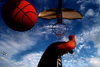 Justin Shea (CQ) 14, ducks out of the way of the falling basketball after dunking the ball in a game with his friend Timi Owa (CQ) 15, 1/8/99. The two friends and St. Pete High freshmen play every day together after school for a couple of hours at Woodlawn Park in St. Petersburg.