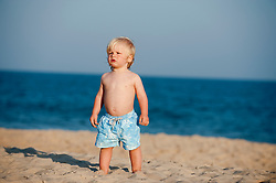 Little blond boy at the beach in East Hampton, NY