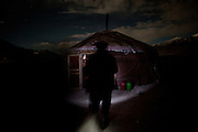Reaching a yurt in the night. Summer camp of Muqur, Er Ali Boi's place...Trekking through the high altitude plateau of the Little Pamir mountains (average 4200 meters) , where the Afghan Kyrgyz community live all year, on the borders of China, Tajikistan and Pakistan.