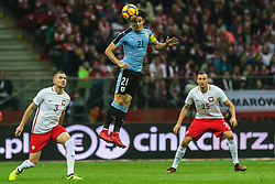 November 10, 2017 - Warsaw, Poland - Edinson Cavani (URU), Artur Jedrzejczyk (POL), Jaroslaw Jach (POL) in action during the international friendly match between Poland and Uruguay at National Stadium on November 10, 2017 in Warsaw, Poland. (Credit Image: © Foto Olimpik/NurPhoto via ZUMA Press)