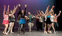 The Dancing with the Lakes Region Stars ensemble welcomes host Corey Henderson to the stage during final rehearsal before the big event Friday evening at 7pm. at the Inter Lakes High School auditorium. (Karen Bobotas/for the Laconia Daily Sun)