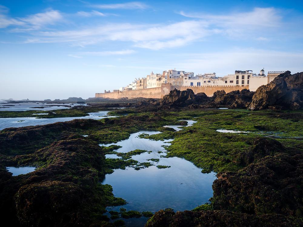 ESSAOUIRA, MOROCCO - CIRCA MAY 2018:  View  of Essaouira, tidal pools and fortified walls.