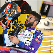 Darrell Wallace Jr. laughs as he preps himself during practice for the 60th Annual NASCAR Daytona 500 auto race at Daytona International Speedway on Friday, February 16, 2018 in Daytona Beach, Florida.  (Alex Menendez via AP)
