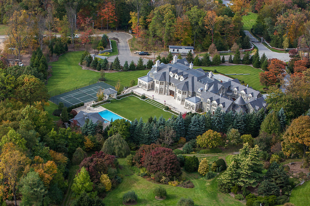 """The """"Stone Mansion"""" in Alpine, New Jersey. Built on the historic Frick Estate. The house has 30,000 square feet on five floors, built of solid granite and steel infrastructure, with 12 bedrooms, 19 bathrooms, indoor basketball court, movie theatre, 11-car garages, 4000-bottle wine cellar and elevator."""