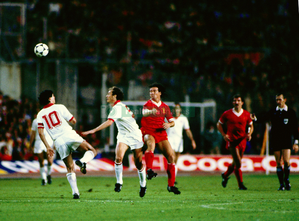 Liverpool's Craig Johnston after jumping for the ball. Liverpool captain Graeme Souness (r) looks on