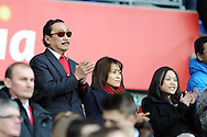 Cardiff city owner Vincent Tan (l) looks on before the match.Barclays Premier league, Cardiff city v Southampton at the Cardiff city Stadium in Cardiff,  South Wales on Boxing day, Thursday 26th Dec 2013. <br /> pic by Andrew Orchard, Andrew Orchard sports photography.