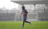 Keshi Anderson struggles to see through the heavy downpour during the Final Thirds Development League match between U21 Crystal Palace and U21 Watford at Selhurst Park, London, England on 24 August 2015. Photo by Michael Hulf.