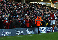 Photo: Javier Garcia/Back Page Images<br />Arsenal v Fulham, FA Barclays Premiership, Highbury, 26/12/04<br />The Clock End hail Thierry Henry after he made it 1-0
