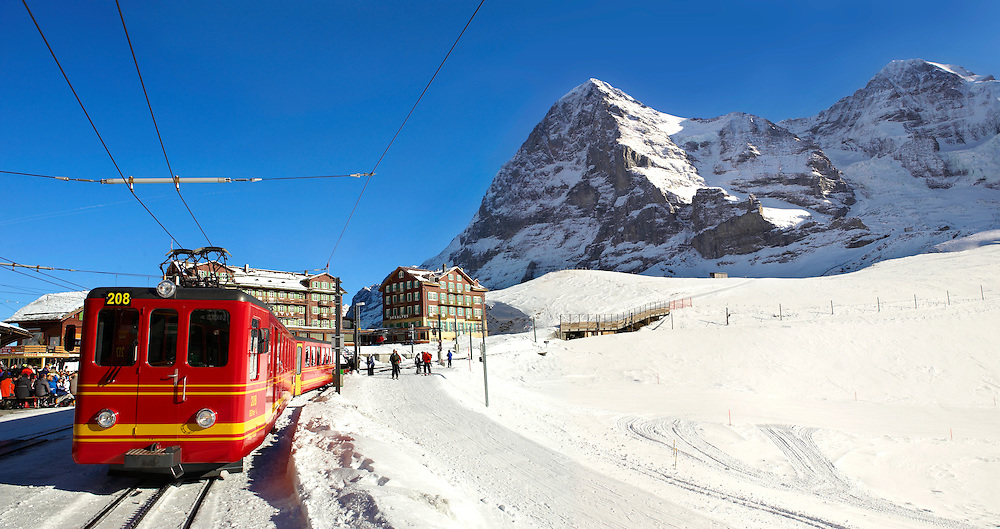 Jungfraujoch train at Kleiner Scheidegg in winter with The Eiger (left) then The Monch Mountains. Swiss Alps Switzerland .<br /> <br /> Visit our SWITZERLAND  & ALPS PHOTO COLLECTIONS for more  photos  to browse of  download or buy as prints https://funkystock.photoshelter.com/gallery-collection/Pictures-Images-of-Switzerland-Photos-of-Swiss-Alps-Landmark-Sites/C0000DPgRJMSrQ3U