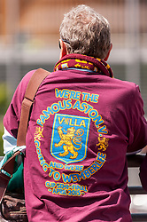 © Licensed to London News Pictures. 30/05/2015. London, UK. An Aston Villa supporter waits, as fans gather at Wembley Stadium for the FA Cup Final 2015, between Arsenal and Aston Villa. Photo credit : Stephen Chung/LNP