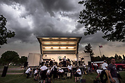 The Robbinsdale City Band had to cut its performance short due to a fast-approaching storm at Victory Memorial Flagpole Thursday May 24, 2018. (Courtney Perry for ClassicalMPR)