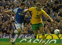 Photo: Glyn Thomas.<br />Birmingham City v Norwich. Carling Cup.<br />26/10/2005.<br />Norwich's Darren Huckerby (R) gets ahead of Damien Johnson.