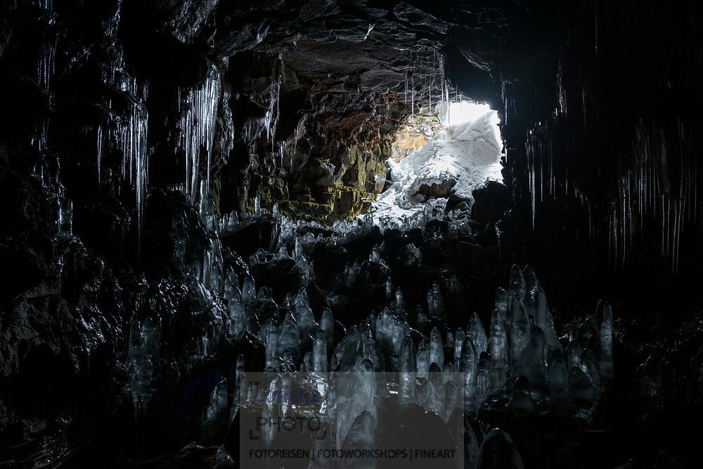 Icicles in the lava cave Raufarholshellir in wintertime, village Thorlakshoefn, Iceland