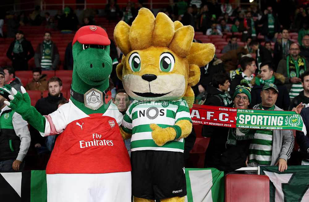 Arsenal mascot Gunnersaurus Rex (left) and Sporting Lisbon mascot Jubas pose for a photo prior to the UEFA Europa League, Group E match at the Emirates Stadium, London.