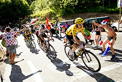 Team Sky's Geraint Thomas (right) and Chris Froome (second right) during stage twelve of the 2018 Tour de France.