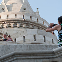 Tourist family poses for a photo on summer sightseeing in Budapest, Hungary on August 25, 2011. ATTILA VOLGYI