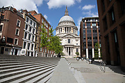 View looking towards St Pauls Cathedral is eerily quiet and silent aside from a few pedestrians on empty streets as lockdown continues and people observe the stay at home message in the capital on 11th May 2020 in London, England, United Kingdom. Coronavirus or Covid-19 is a new respiratory illness that has not previously been seen in humans. While much or Europe has been placed into lockdown, the UK government has now announced a slight relaxation of the stringent rules as part of their long term strategy, and in particular social distancing.