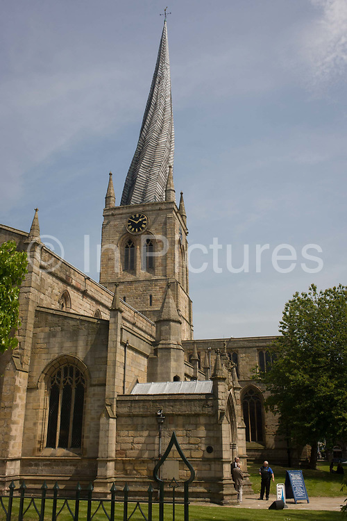 The crooked church steeple of Church of St Mary and All Saints in Chesterfield, Derbyshire. It's believed that the twisting of the spire was caused by the lead that covers the spire. Chesterfield Parish Church is an Anglican church dedicated to Saint Mary and All Saints, located in the town of Chesterfield in Derbyshire, England. Predominantly dating back to the 14th century, the church is a Grade I listed building and is most known for its twisted spire, an architectural phenomenon which has led to the church being given the common byname of the Crooked Spire.