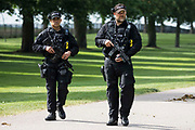 Authorised firearms officers AFOs from Thames Valley Police patrol the Long Walk in Windsor Great Park prior to the ceremony of Trooping the Colour at Windsor Castle to mark the Queens official birthday on 12th June 2021 in Windsor, United Kingdom. A socially distanced and scaled down Trooping the Colour ceremony is taking place this year incorporating many of the elements from the annual ceremonial parade on Horse Guards, with F Company Scots Guards Trooping the Colour of the 2nd Battalion Scots Guards in the Castle Quadrangle.