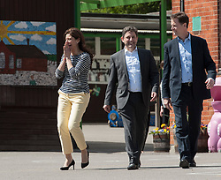 © Licensed to London News Pictures.  29/04/2015. Chippenham, Wiltshire, UK.  Deputy Prime Minister and leader of the Liberal Democrats Nick Clegg and his wife Miriam González Durántez visit a primary school in Chippenham to campaign alongside local candidate Duncan Hames (centre).  They visited Ivy Lane Primary School to meet pupils and teachers. They helped to prepare and serve lunch at the school before talking to staff about how pupils are benefiting from the Pupil Premium and capital funding to support the provision of universal free school meals.  The Liberal Democrats have set out education funding as a red line and would not enter coalition with any party that does not agree to protect per pupil funding from nursery to 19, in real terms.  Photo credit : Simon Chapman/LNP