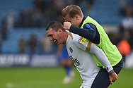 Peterborough United midfielder Callum Cooke (14) celebrates with a team mate after the EFL Sky Bet League 1 match between Gillingham and Peterborough United at the MEMS Priestfield Stadium, Gillingham, England on 22 September 2018. Picture by Martin Cole