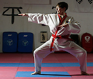 Flo Covell, 63, of the Town of Wallkill works out at Baez Tang Soodo Studio on Route 211 in the Town of Wallkill on March 8, 2006.